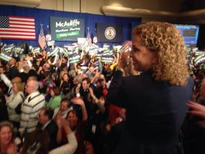 DNC chair Debbie Wasserman-Schultz celebrates when the Virginia governor's race is called for Terry McAuliffe.
